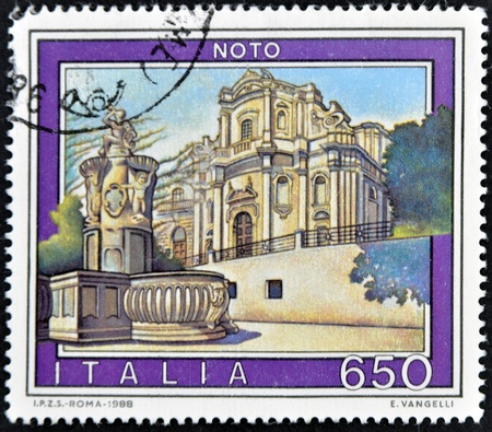 ITALY - CIRCA 1988: A stamp printed in Italy shows Noto, circa 1988 Stock Photo - 11813780