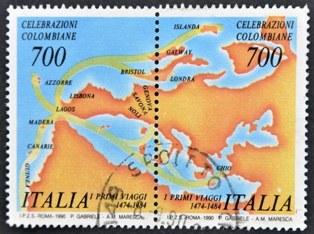 ITALY - CIRCA 1990: A stamp printed in Italy dedicated to Columbian celebrations, shows the first trip, circa 1990 photo