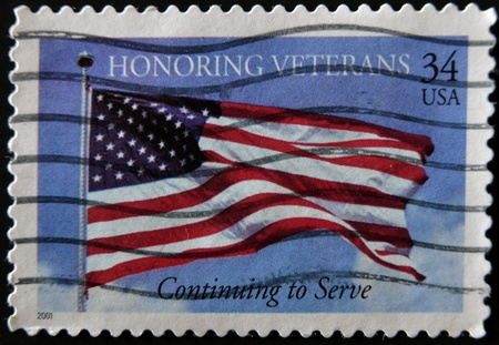 united states postal service: UNITED STATES OF AMERICA - 2001: A stamp printed in USA shows image of the US flag, honoring veterans, circa 2001  Stock Photo