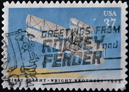 united states postal service: UNITED STATES OF AMERICA - CIRCA 2003: A stamp printed in USA shows image celebrating the 100th anniversary of the first flight by the Wright Brothers, circa 2003  Stock Photo