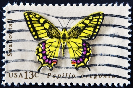 UNITED STATES - CIRCA 1977: stamp printed in USA shows butterfly Swallowtail, circa 1977  photo