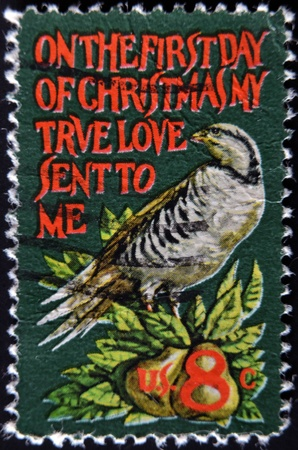 UNITED STATES - CIRCA 1971: stamp printed in USA shows partridge in a pear tree, circa 1971  photo