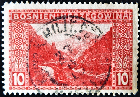 hercegovina: Bosnia and Hercegovina - CIRCA 1915: A stamp printed in Bosnia shows mountains, rivers and road, circa 1915  Stock Photo