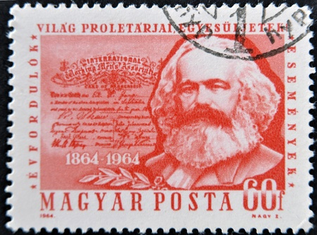 sociologist: HUNGARY - CIRCA 1964: A stamp printed in Hungary shows image of Karl Marx, famous communism sociologist, circa 1964