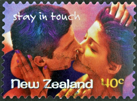 NEW ZEALAND- CIRCA 1998: A stamp printed in New Zealand shows couple kissing, stay in touch, circa 1998 photo