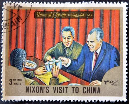 umm: UMM AL QIWAIN - CIRCA 1966: A stamp printed in UAQ shows Nixon�s visit to China, circa 1966