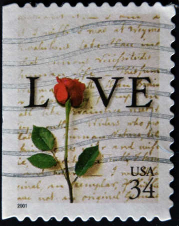 postage stamp: UNITED STATES - CIRCA 2001: A stamp printed in the USA shows word LOVE end red rose, circa 2001