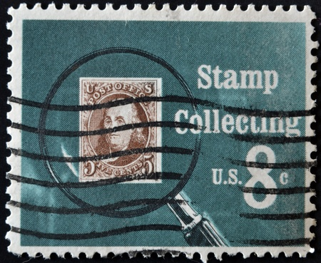 UNITED STATES OF AMERICA - CIRCA 1972: A stamp printed in USA shows Pictures magnifying glass over United States postage stamp, circa 1972