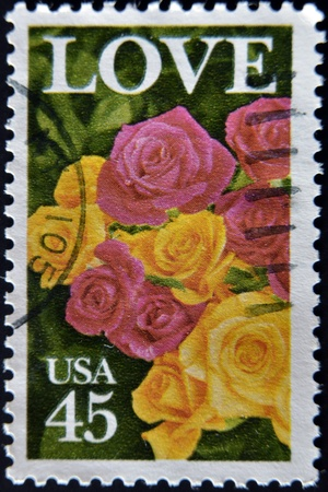 UNITED STATES OF AMERICA - CIRCA 1990: A stamp printed in USA shows image photo of beautiful roses, circa 1990 photo