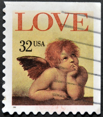 perforated stamp: UNITED STATES OF AMERICA - CIRCA 1995: A stamp printed in the United States of America shows image of cupid, circa 1995  Stock Photo