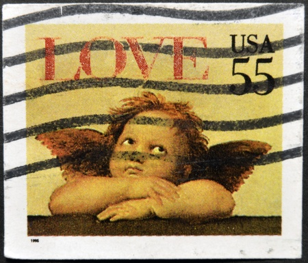 UNITED STATES OF AMERICA - CIRCA 1995: A stamp printed in the United States of America shows image of cupid, circa 1995 Stock Photo - 11949241