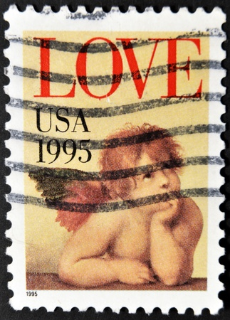 cancelled stamp: UNITED STATES OF AMERICA - CIRCA 1995: A stamp printed in the United States of America shows image of cupid, circa 1995  Stock Photo