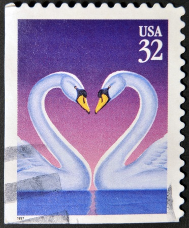 UNITED STATES OF AMERICA - CIRCA 1997: Love Swans stamp printed in the USA, circa 1997  photo