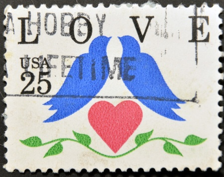 UNITED STATES OF AMERICA - CIRCA 1990: stamp printed in the USA shows dove - a symbol of love, circa 1990  photo