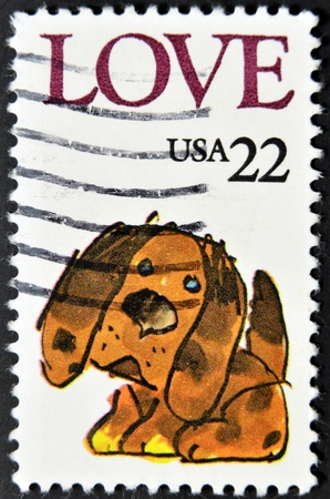 UNITED STATES - CIRCA 1986: stamp printed in USA shows puppy, circa 1986  Stock Photo - 11949287