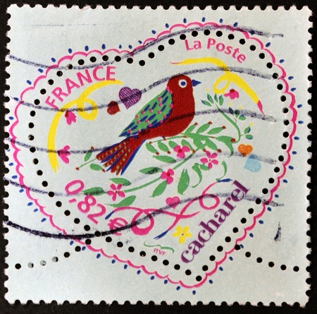 FRANCE - CIRCA 2003: A stamp printed in France shows a heart by Cacharel, circa 2003  photo