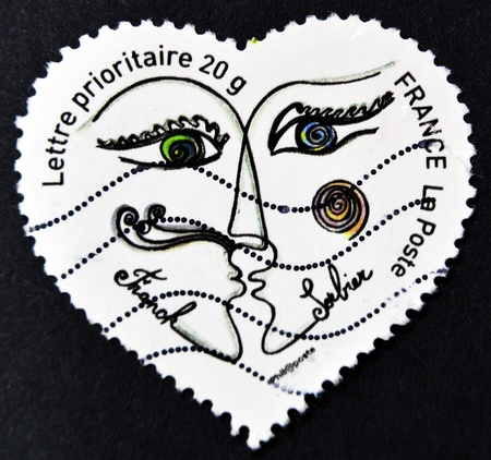 pret a porter: FRANCE - CIRCA 2003: A stamp printed in France shows two people kissing in a heart by Franck Sorbier, circa 2003