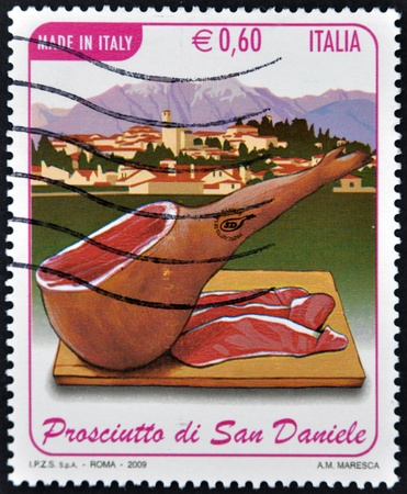 ITALY - CIRCA 2009: A stamp printed in Italy dedicated to ham of San Daniel, circa 2009 photo