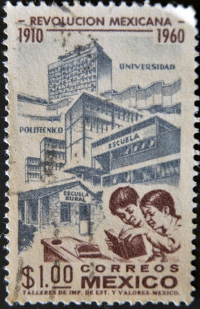 MEXICO - CIRCA 1960: A stamp pritned in Mexico shows advances in education with the Mexican Revolution, circa 1960 Stock Photo