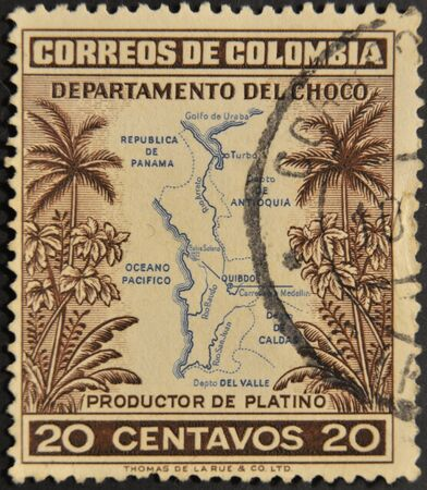 COLOMBIA - CIRCA 1940: A stamp printed in Colombia shows map of the department of Choco, producer of platinum, circa 1940 photo