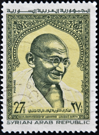 syria peace: SYRIAN ARAB REPUBLIC - CIRCA 1969: A stamp printed in Syria shows Mahatma Gandhi, circa 1969