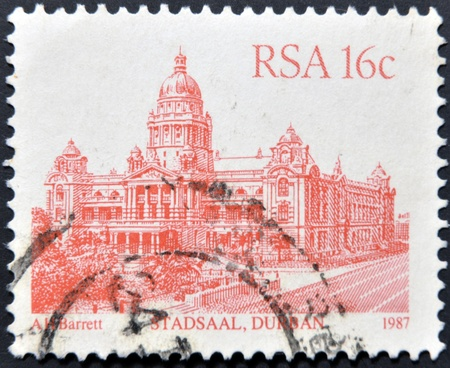 suid: SOUTH AFRICA - CIRCA 1986: A stamp printed in South Africa shows image of the Stadsaal building in Durban, circa 1986  Stock Photo