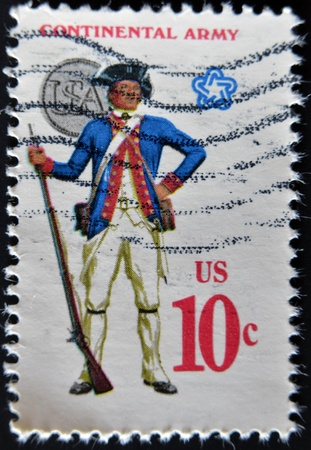 musket: UNITED STATES - CIRCA 1970: A stamp printed in usa shows military uniform of the American Continental Army. Soldier with flintlock musket and uniform button.  CIRCA 1970  Stock Photo