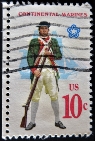 musket: UNITED STATES - CIRCA 1970: A stamp printed in USA shows  Military uniform of the American Continental Marines. Marine with musket, fullrigged ship background, CIRCA 1970