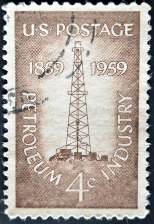 united states postal service: USA - CIRCA 1959 : A stamp printed in USA show Petroleum Industry with first oil well at Titusville, Pennsylvania, circa 1959