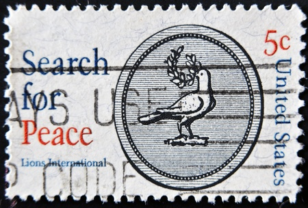 USA - CIRCA 1967: A stamp printed in USA shows a dove with the words Search Stock Photo - 11950360