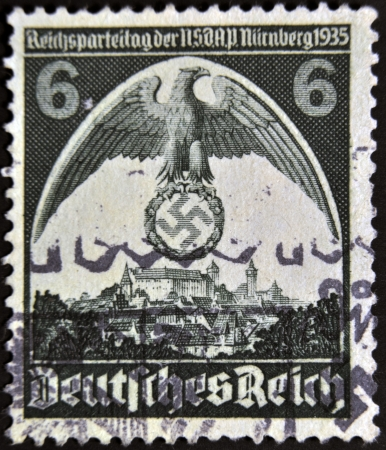 reich: GERMAN REICH - CIRCA 1935: A stamp printed in Germany shows nazi eagle badge, circa 1935
