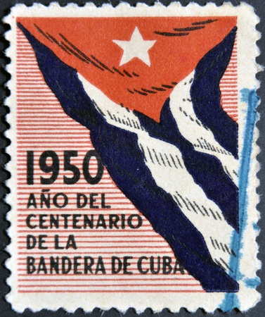 CUBA FLAG: CUBA - CIRCA 1950: A stamp printed in Cuba dedicated to the centenary of the flag of Cuba, circa 1950 Stock Photo