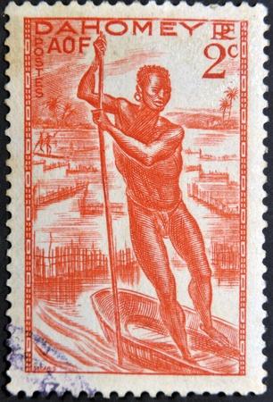 poling: DAHOMEY CIRCA 1941: stamp printed by Dahomey, shows Man Poling a Canoe, circa 1941