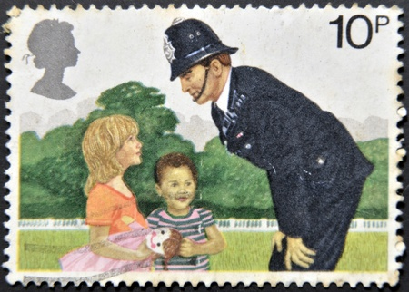 constable: UNITED KINGDOM - CIRCA 1979: a stamp printed in the Great Britain shows Police Constable and Children, 150th anniversary of London Metropolitan Police, circa 1979