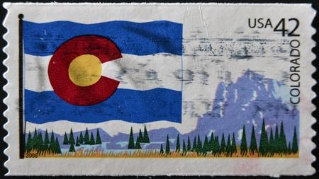 colorado flag: UNITED STATES OF AMERICA - CIRCA 2009: A stamp printed in USA dedicated to Colorado, circa 2009