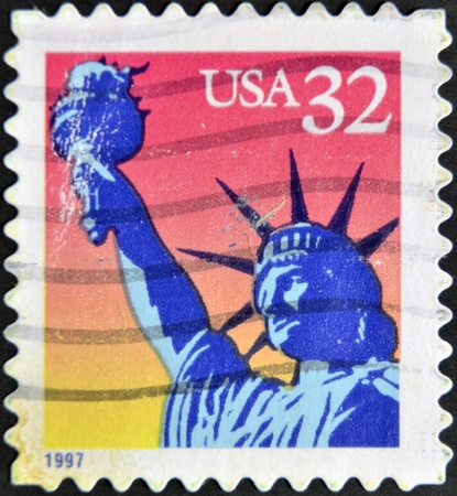 UNITED STATES OF AMERICA - CIRCA 1997: A stamp printed in USA shows image of Statue of Liberty, circa 1997  photo