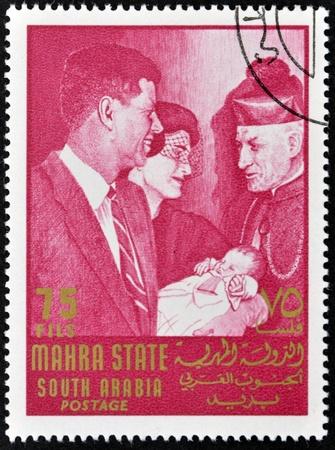john fitzgerald kennedy: SOUTH ARABIA - CIRCA 1967: stamp printed by South Arabia, shows John Fitzgerald Kennedy and Jacqueline, circa 1967 Editorial
