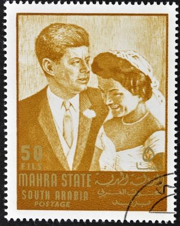 john fitzgerald kennedy: SOUTH ARABIA - CIRCA 1967: stamp printed by South Arabia, shows Wedding of John Fitzgerald Kennedy and Jacqueline, circa 1967 Editorial