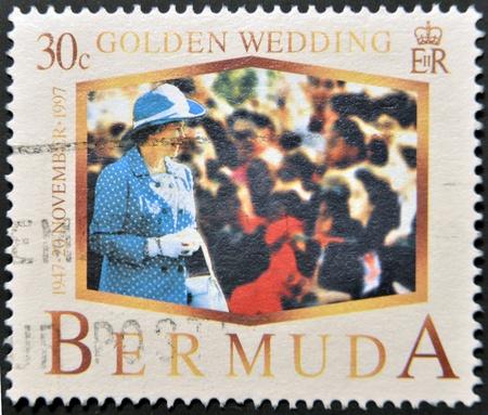 BERMUDA - CIRCA 1997: A stamp printed in Bermuda shows Queen Elizabeth II, golden wedding, circa 1997 Stock Photo - 12201280