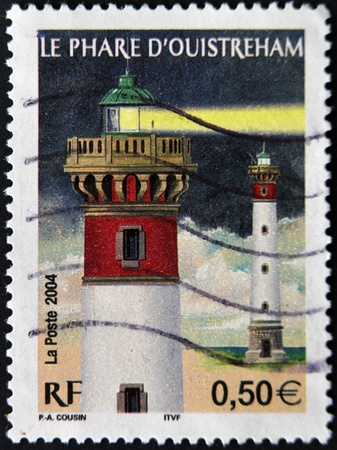 flagship: FRANCE - CIRCA 2004: A stamp printed in France shows the flagship ouistreham in the night, circa 2004