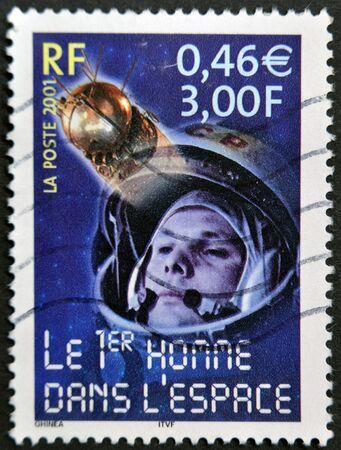 gagarin: FRANCE - CIRCA 2001: A stamp printed in France shows Yuri Gagarin, the first man in space, circa 2001