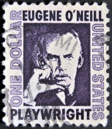 laureate: UNITED STATES OF AMERICA - CIRCA 1973: a stamp printed in the United States of America shows Eugene O´Neill, American playwright and Nobel laureate in Literature, circa 1973  Editorial