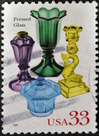 UNITED STATES OF AMERICA - CIRCA 1999: A stamp printed in USA shows pressed glass, circa 1999 photo