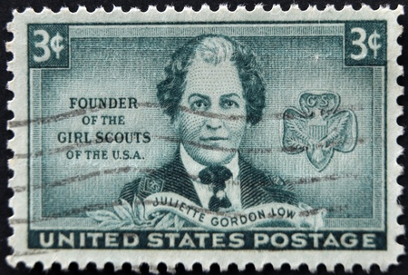 founder: UNITED STATES - CIRCA 1948: A stamp printed in USA shows Juliette Gordon Low, Founder of the Girls Scouts of the USA, circa 1948  Editorial