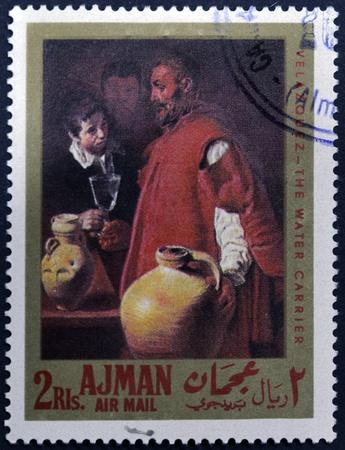 velazquez: AJMAN - CIRCA 1968: A stamp printed in Ajman shows the water carrier by Velazquez, circa 1968