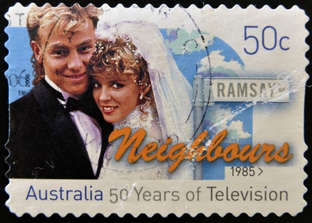 neighbours: AUSTRALIA - CIRCA 1985: A stamp printed in Australia shows frame from the movie Neighbours, circa 1985