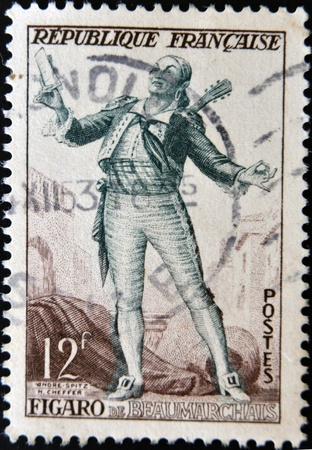 FRANCE - CIRCA 1950: a stamp printed in France shows image of Figaro, the literary character created by  Moliere, circa 1950 Stock Photo - 12201347