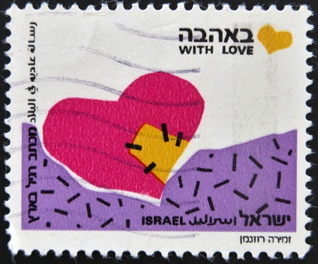ISRAEL - CIRCA 1989: A stamp printed in Israel shows heart and words With Love, circa 1989  photo