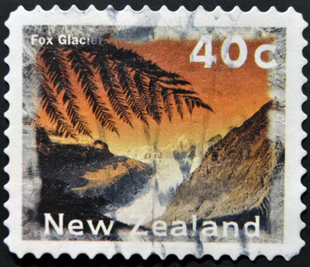 NEW ZEALAND - CIRCA 1996: A stamp printed in New Zealand shows Fox Glacier, circa 1996  photo