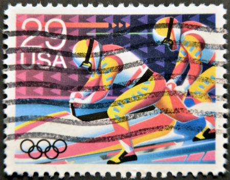 UNITED STATES OF AMERICA - CIRCA 1992: A stamp printed in USA dedicated to Winter Olympics, shows bob-sledding, circa 1992